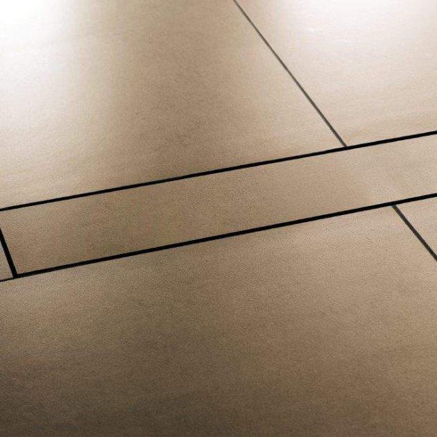 Dušas kanālu KERDI-LINE-D dizaina nosedzošais vāks, bez rāmja seguma nostiprināšanai nodrošinot saķeri ar flīžu līmi un piemērots visiem seguma biezumiem